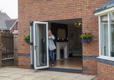 Grey Aluminium Bi-Folding Doors by Force 8