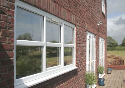 Contemporary white PVCU replacement windows and french doors